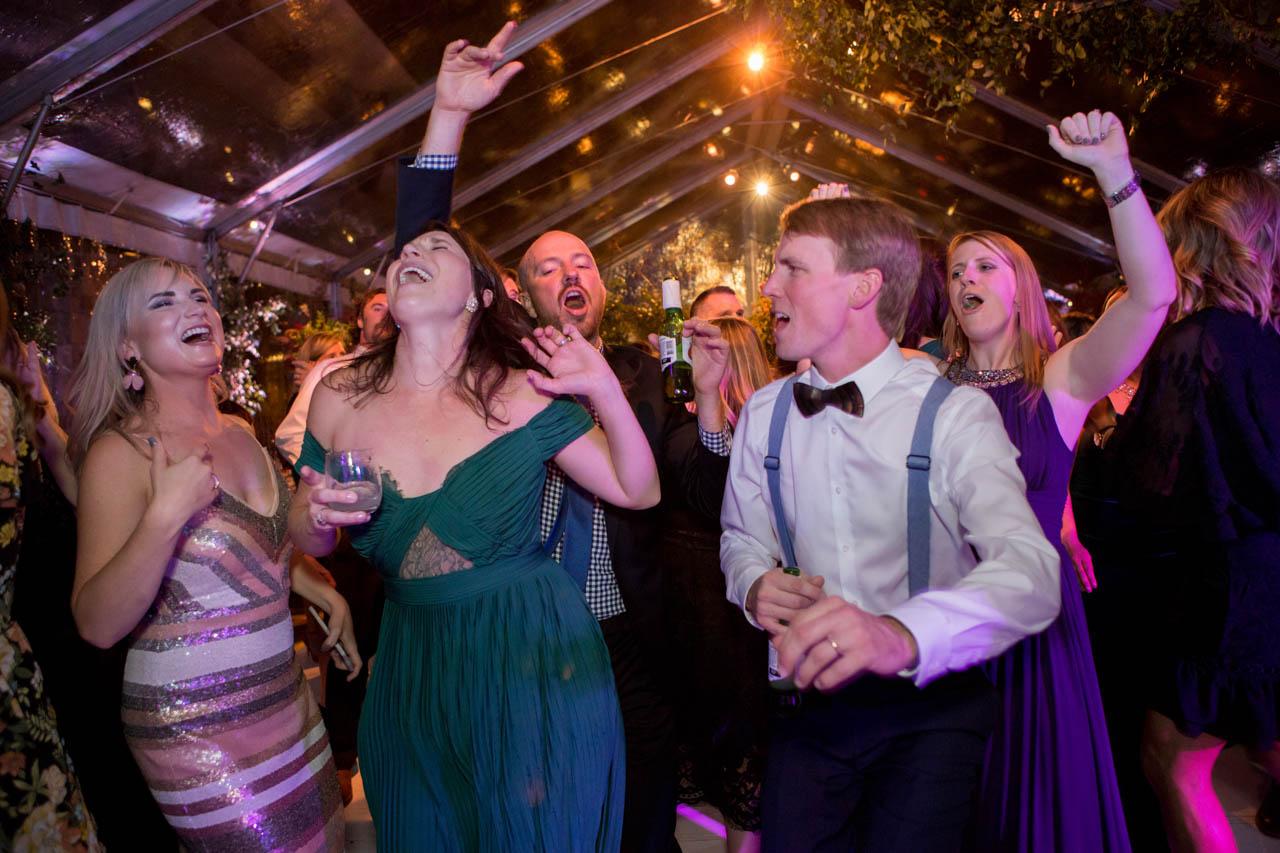 Wedding guests enjoy dancing the night away.