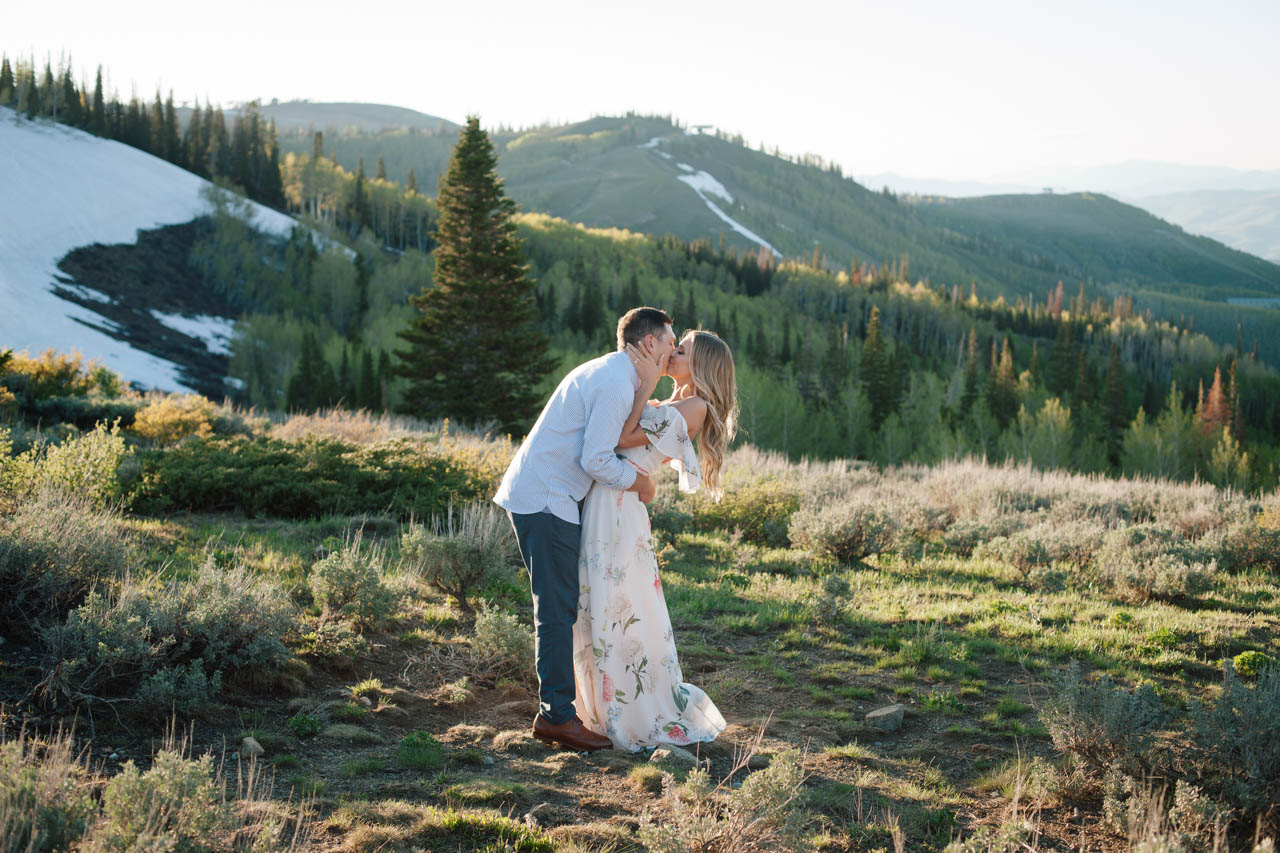 Couple in dramatic mountain scenery at Empire Pass in Park City, Utah.