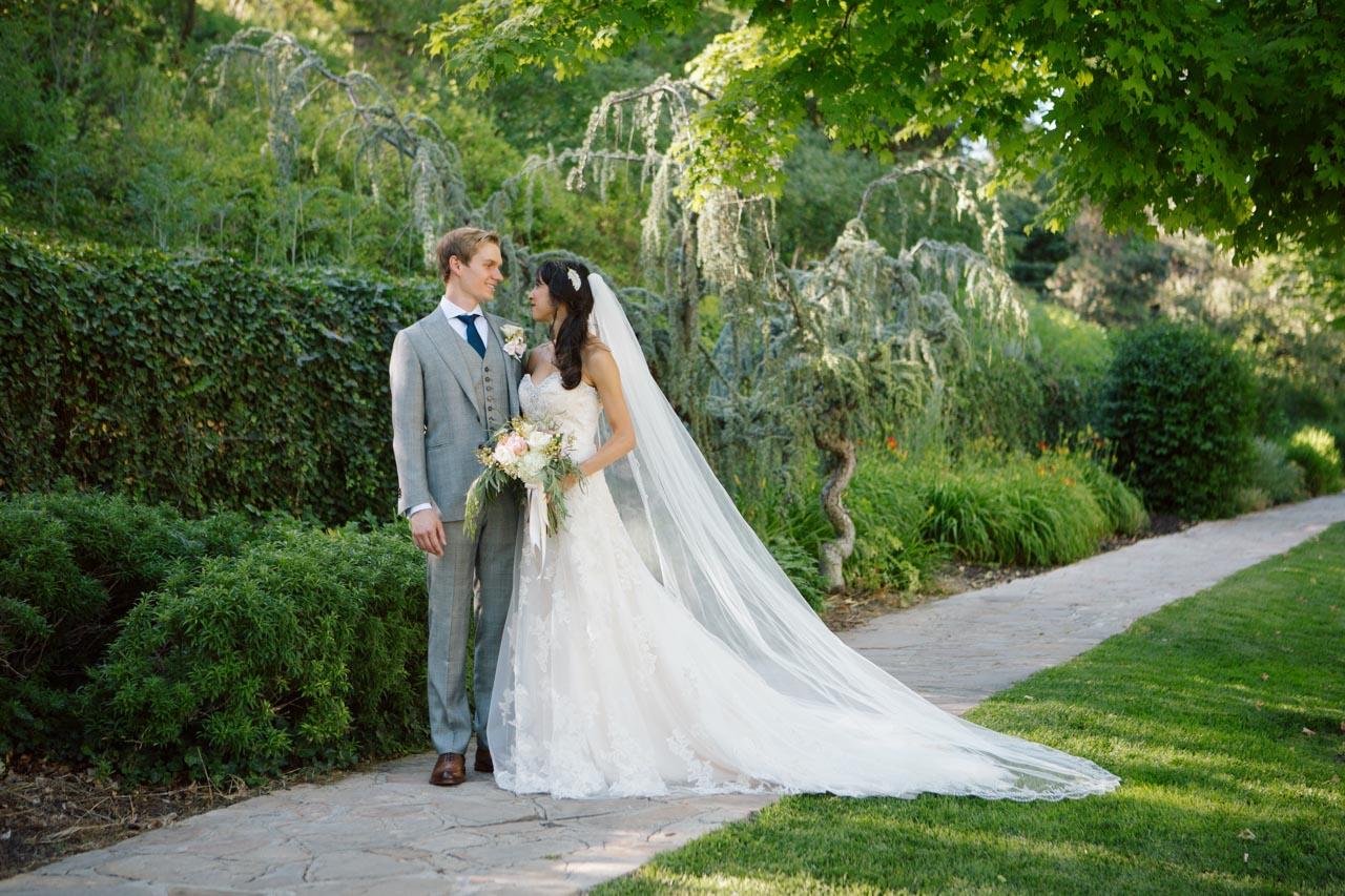 Wedding couple in lush gardens at Memory Grove.