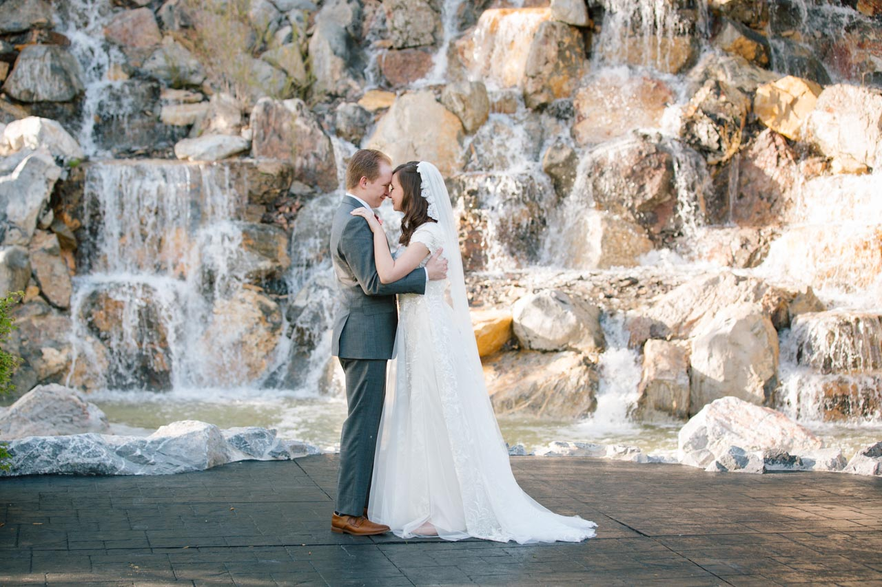 Wedding couple dances in front of the waterfall at Millennial Falls.