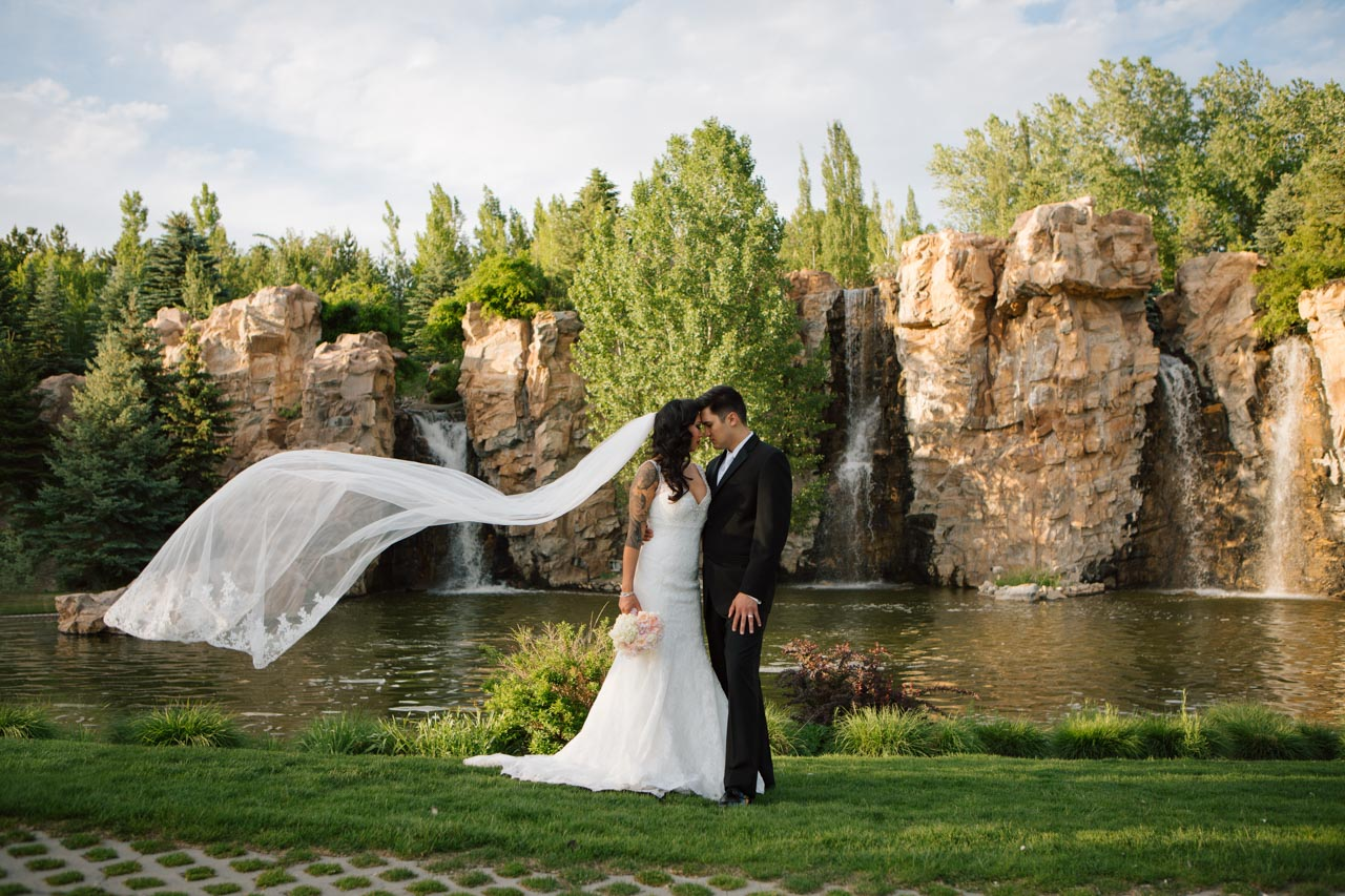 Couple in front of Thanksgving Point waterfall.