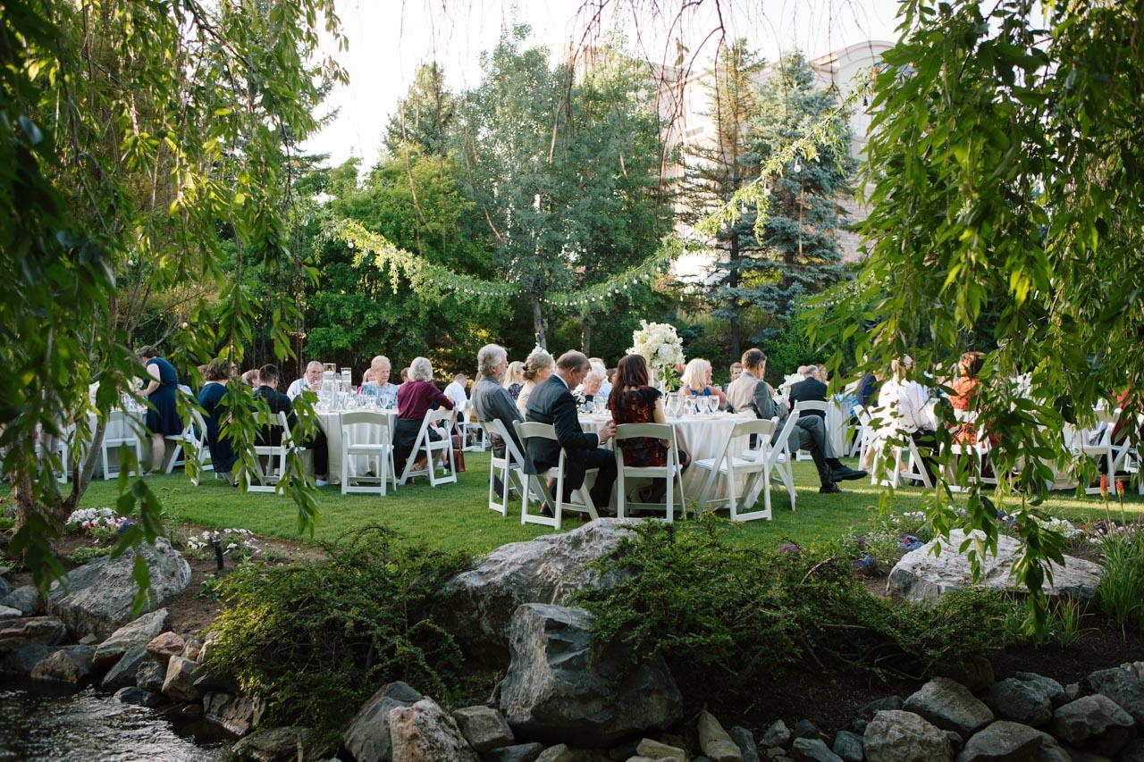 Wedding guests enjoy a reception at Hidden Falls.