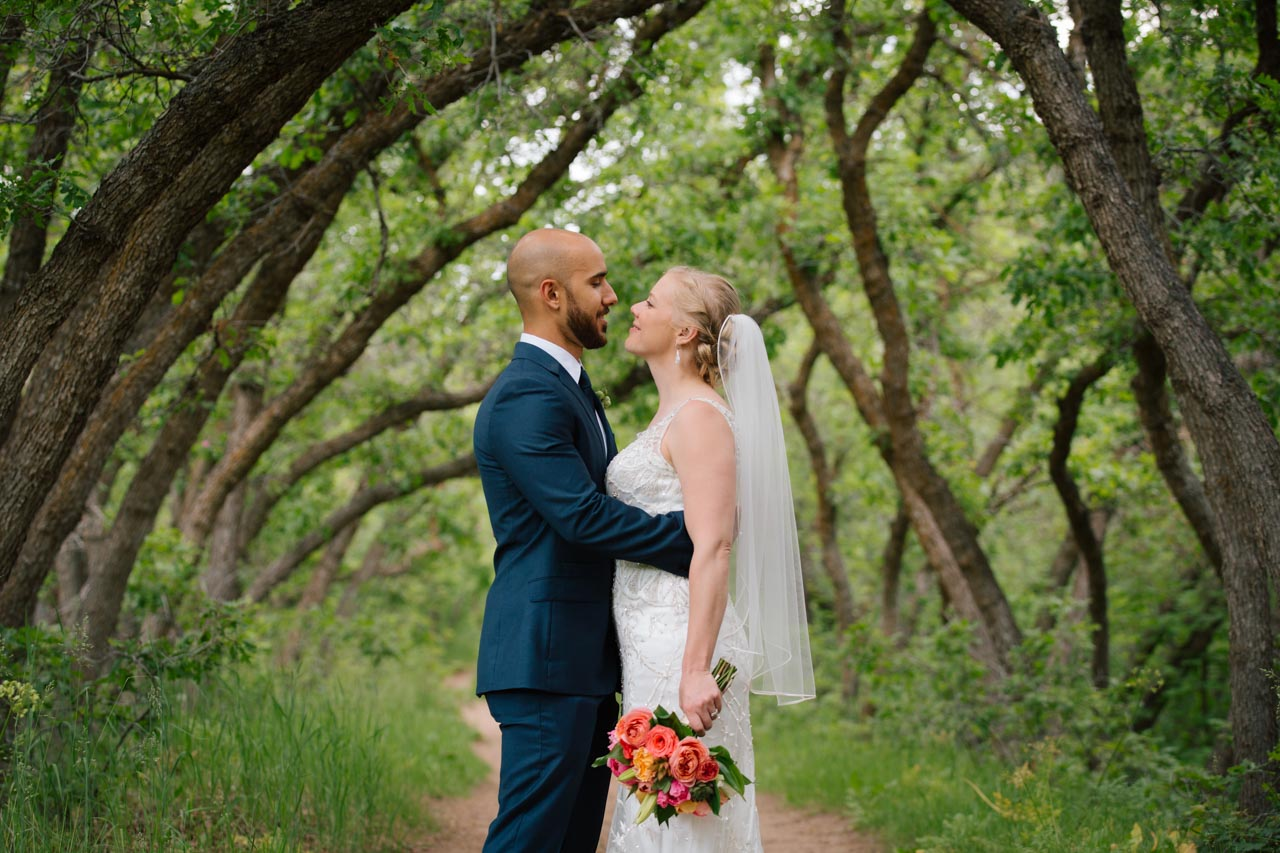 Couple embraces in the Oak Tunnel at Red Butte Gardens.