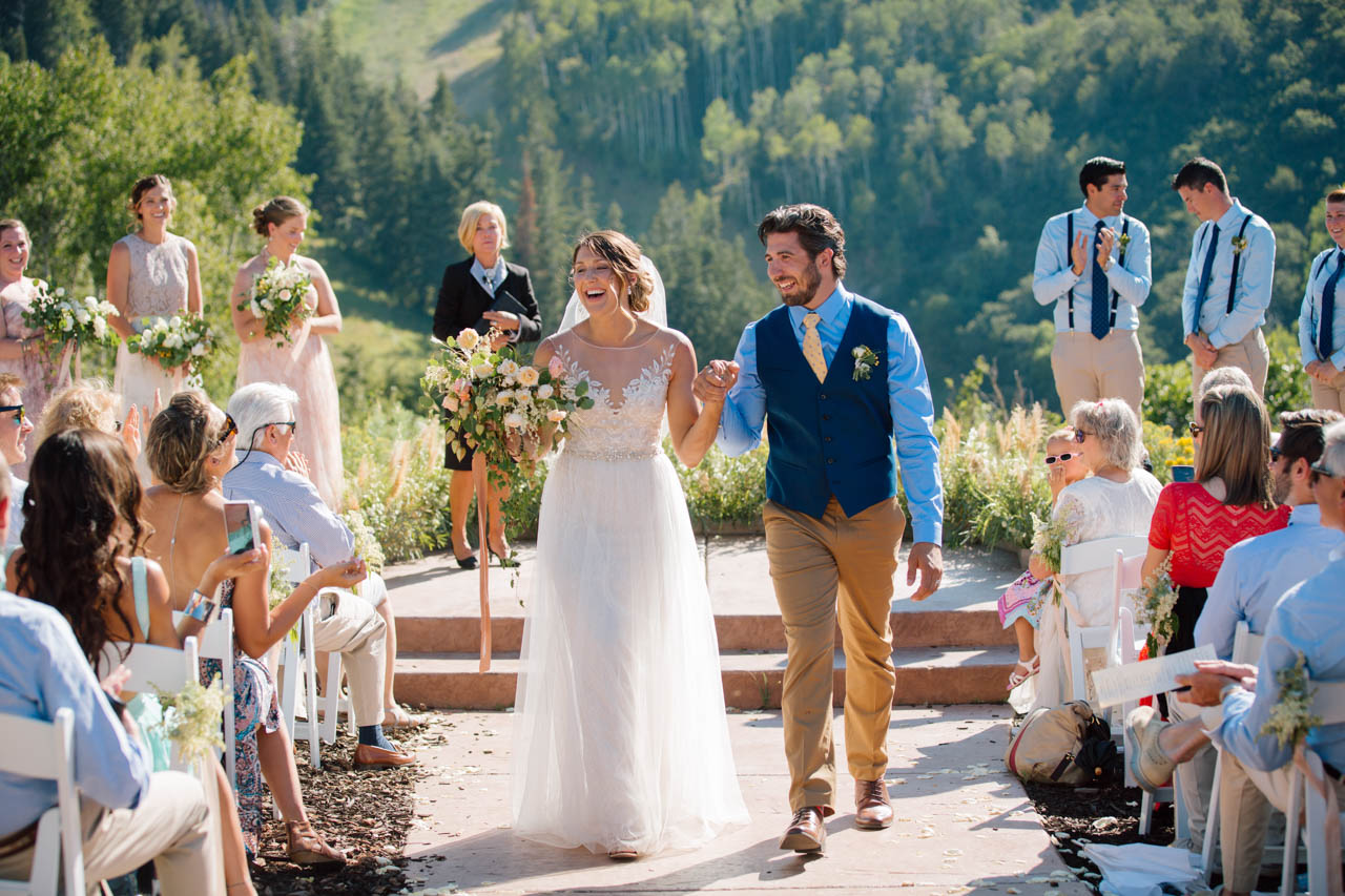 Couple exit after wedding ceremony at Alpine meadows.
