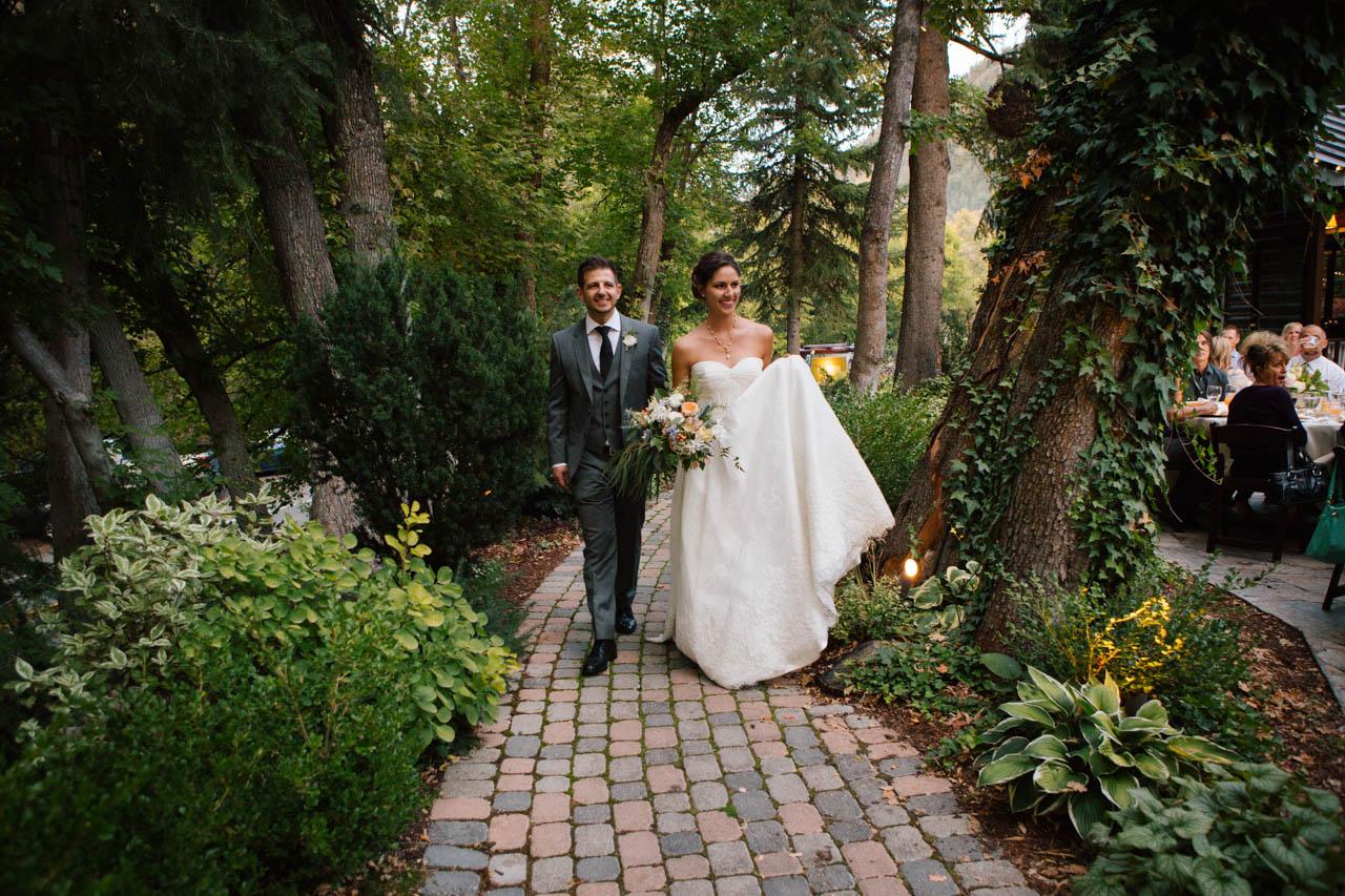The wedding couple enters their reception at Millcreek Inn.